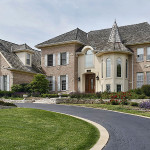 Luxury home with turret and cedar roof