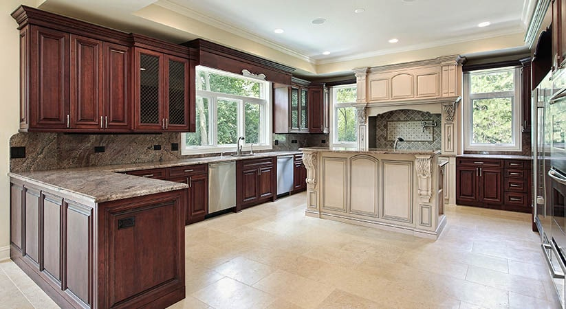 The natural wood slab on the island, the thick granite ...